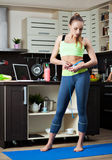 Dieting girl on her kitchen Royalty Free Stock Images