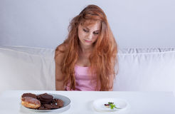 Dieting girl in her room Stock Photography