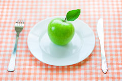 Dieting. A dieting with green apple stock images