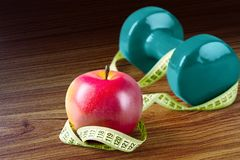 Dieting. Healthy Eating Weight Exercising Apple Healthy Lifestyle Dumbbell Royalty Free Stock Images