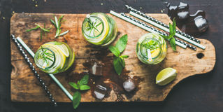Dieting healthy infused citrus iced sassi water in glass bottles. Citrus fruit and herbs infused sassi water for detox, healthy eating, dieting in glass bottles Royalty Free Stock Photography