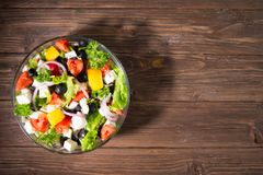 Dieting healthy salad on rustic wooden table top view.  stock photography