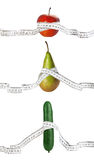 Dieting and measurements. Apple, pear and cucumber like woman figure's types, with tape measures Stock Images
