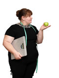 Dieting overweight women. With scales and apple Stock Images