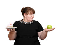 Dieting overweight woman choice. Dieting overweight women choice isolated on white Royalty Free Stock Photos