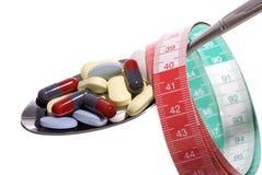 Dieting with Pills. Close up (macro), studio shot Stock Photos