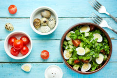 Dieting salad with lettuce, cherry tomatoes, cucumber and quail Stock Photo