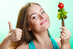 Dieting weight loss concept. Girl with vegetables Stock Photography