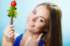 Dieting weight loss concept. Girl with vegetables Stock Image