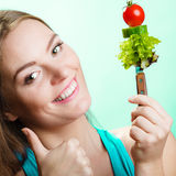 Dieting weight loss concept. Girl with vegetables Stock Images