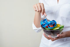 Dieting weight loss concept. young woman holding fork with fresh Stock Photo