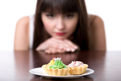 Dieting woman craving for cake Royalty Free Stock Images