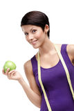 Dieting woman with flexible ruler and green apple Stock Image