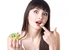 Dieting woman got caught while eating cake royalty free stock images