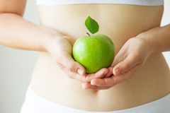 Dieting. Woman dieting with green apple royalty free stock photography
