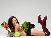Dieting. Woman hold bunch of radish lettuce broccoli happy smili Royalty Free Stock Images