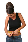 Dieting Woman Measuring Her Weight Stock Images