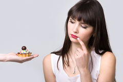 Dieting woman is offered cake Royalty Free Stock Images