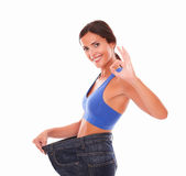 Dieting young woman gesturing ok sign Royalty Free Stock Photo