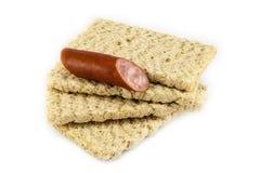 Dietiskt bröd på en vit bakgrund Arkivbilder