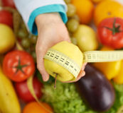 Dietitian with apple Royalty Free Stock Photography
