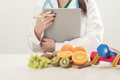 Dietitian doctor. On white Royalty Free Stock Photography