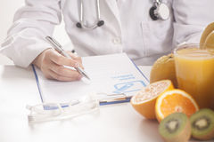 Dietitian doctor. Writing a diet list Stock Images