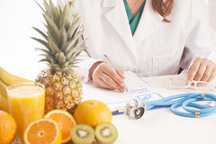 Dietitian doctor. Writing a diet list Royalty Free Stock Photo