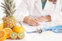 Dietitian doctor. Writing a diet list Stock Photos