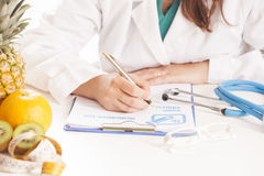 Dietitian doctor. Writing a prescription Stock Images