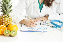 Dietitian doctor. Writing a prescription Royalty Free Stock Image