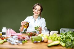 Dietitian making a salad royalty free stock images