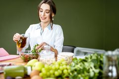 Dietitian making a salad stock image