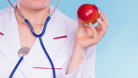 Dietitian nutritionist with apple fruit. Royalty Free Stock Photography