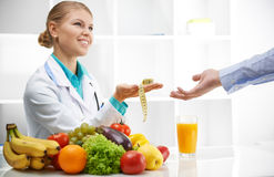 Dietitian and patient in office Royalty Free Stock Photos