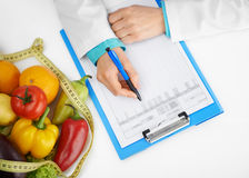 Dietitian prescribing treatment Royalty Free Stock Image