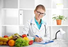 Dietitian prescribing treatment Stock Photos