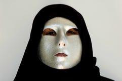 Dietro la mascherina immagine stock