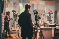 Dietro la scena Macchina fotografica multipla Spirito di scena del film della fucilazione del cineoperatore fotografie stock