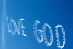 Dieu d'amour dans le ciel Photo stock