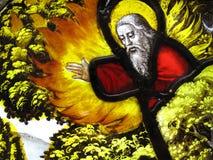 Dieu sur un windo médiéval en verre souillé Images stock