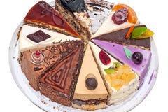 Diez diversos pedazos de torta en una placa Foto de archivo