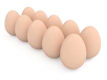 Diez huevos en una fila aislada en blanco Foto de archivo libre de regalías