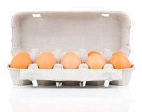 Diez huevos marrones Imagenes de archivo