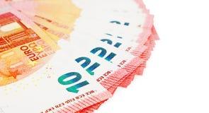 Diez notas de los euros sobre la exhibición en un fondo blanco Imagenes de archivo