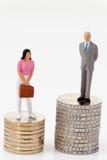 Diferencias de género en sueldos Fotos de archivo