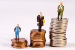 Diferencias en sueldos Foto de archivo