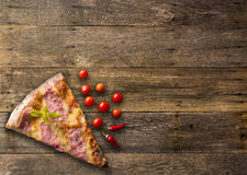 Diferents types of pizza cut on wooden table Stock Photos