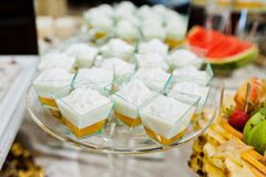 Diferrent cup cakes at wedding reception table.  royalty free stock photos