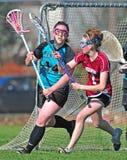 Difesa 01 di Lacrosse delle ragazze Immagine Stock Libera da Diritti
